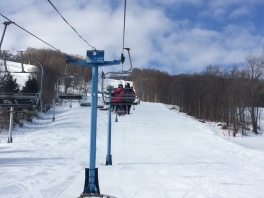 Hunt Hollow - Couple on lift - sunny day